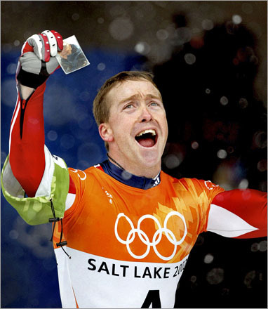 Buy photographs by Barry Chin In one of the most poignant moments of the 2002 winter Olympics in Salt Lake City, third generation Olympian Jim Shea Jr. celebrates his emotional gold medal victory in the Skelton final by holding a photo of his grandfather Jack, who was killed in a car accident 28 days before by a drunk driver, and who 70 years ago won two gold medals for speed skating in the 1932 Olympic Games. 'I felt him here today and at the opening ceremonies,' said Jim Jr. 'He had some unfinished business before he went to heaven. Now he can go.'