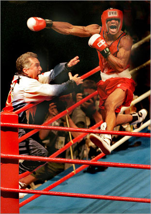 Buy this picture! American David Reid leaps into his corner after knocking out his Cuban opponent to win an unexpected gold medal at the 1996 Olympics in Atlanta, GA.