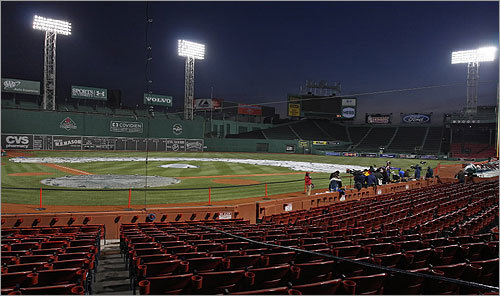 Eight hours before the first pitch, the media set up in a darkened Fenway Park in anticipation of the pregame ceremonies and the arrival of the championship rings.