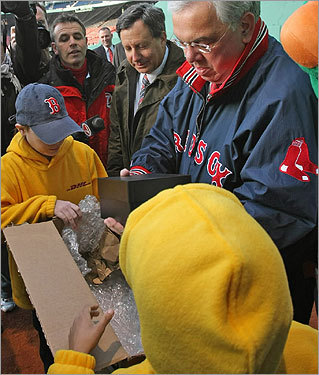 The rings were delivered to Red Sox chairman Tom Werner (center) and Mayor Menino (right) by honorary couriers representing each of the Red Sox Foundation's four youth programs. Two couriers admired the ring in Menino's hand.
