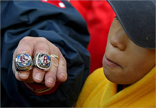 Menino showed off the 2007 and 2004 World Series rings to courier LaJuan Allen.