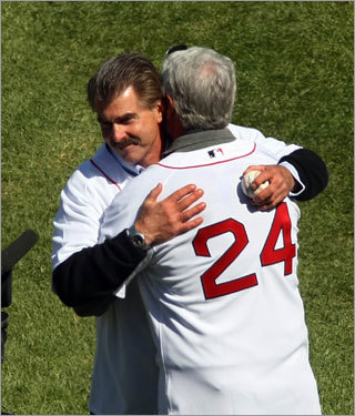 Bill Buckner is hugged by former teammate Dwight Evans after he threw out the ceremonial first pitch.