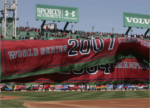 The 2007 World Series banner is unfurled over the left-field wall during the pregame ceremonies.