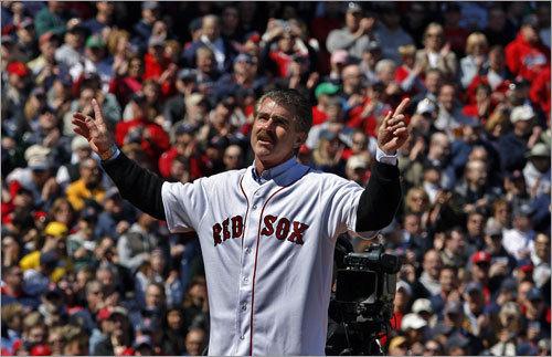 Bill Buckner motions to the fans.