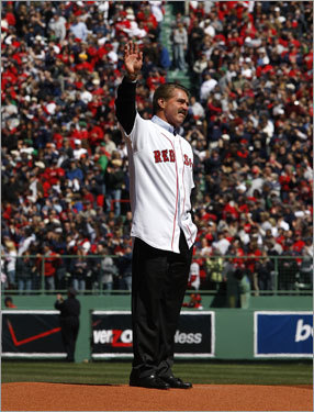 Bill Buckner acknowledges the standing ovation he received before throwing out the ceremonial first pitch.