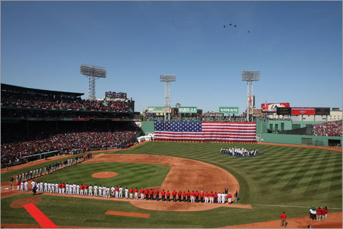 F16 jets fly over Fenway Park during opening ceremony.