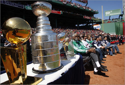 Championship trophies from each of the major sports teams in Boston sit along the third-base line.