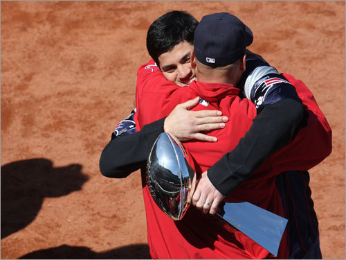 Tedy Bruschi of the New England Patriots hugs Red Sox manager Terry Francona before Tuesday's game.