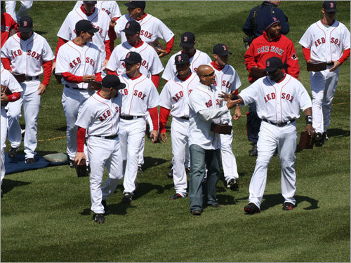 Members of the 2007 Red Sox head in from the field after receiving their 2007 World Series rings.