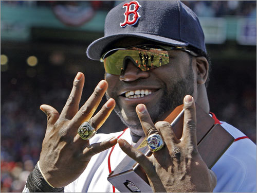 David Ortiz flashes his World Series rings -- and a smile.