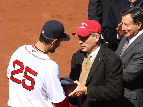 Mike Lowell receives a World Series ring from Red Sox chairman Larry Lucchino.