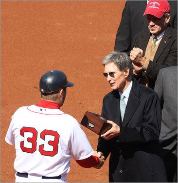 Red Sox captain Jason Varitek (33) receives his World Series ring.