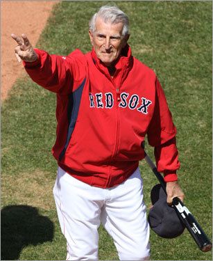 Red Sox legend Johnny Pesky motions to the crowd before the game.