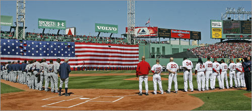 Before Tuesday's home opener, the Tigers (left) and the Red Sox lined up along their respective baselines.