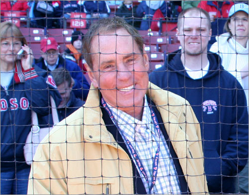 Outgoing WBZ TV sports director Bob Lobel gets ready to have a seat behind home plate next to front row fixture Dennis Drinkwater, founder of Giant Glass. Lobel promised he would turn his cellphone off, one of the requirements Drinkwater has for his guests.