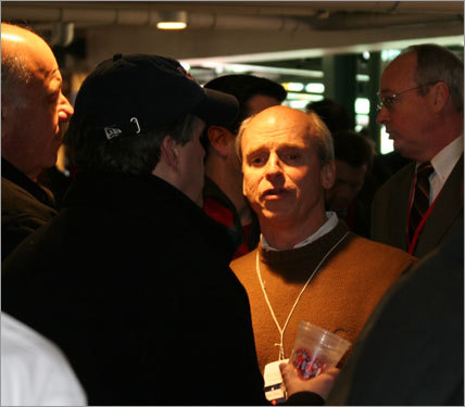 Tom Finneran, local talk radio station host and former speaker of the Massachusetts House, holds court at a pregame party inside Fenway Park.