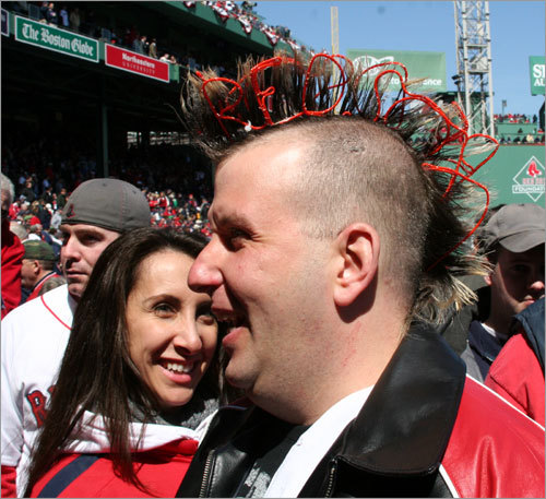 Michael Groves from Boston breaks out the Red Sox sign for his mohawk on Opening Day at Fenway. Groves also gives his 'hawk the special treatment for big Patriots games, too. No word on whether the Fenway Hawk is jealous of the Groves's mohawk.