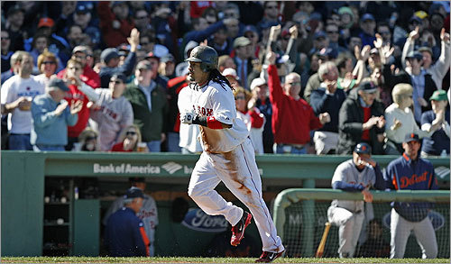 After diving into third, Manny Ramirez was awarded home and credited with a triple and a scored run after a throwing error by Detroit second baseman Placido Polanco.