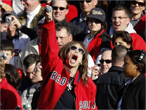 Aerosmith lead singer Steven Tyler sings God Bless America during the seventh inning on Opening Day at Fenway Park.