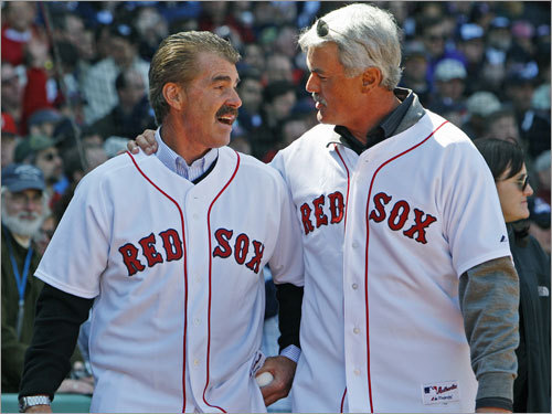 Red Sox alumni Bill Buckner and Dwight Evans embraced before the game.