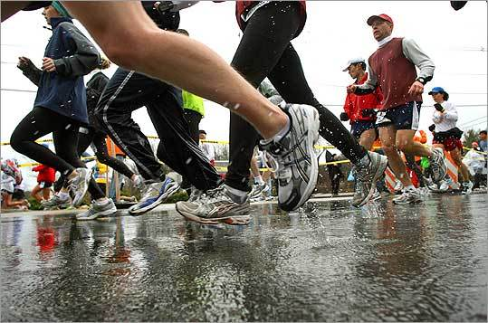 As if running 26.2 miles wasn't enough, participants in the 2007 race faced the added burden of wet sneakers and heavy clothes.