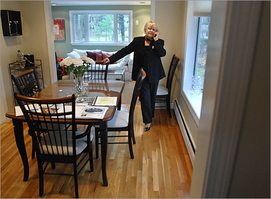 Realtor Dana Mastovsky waits for visitors at an open house in a Natick split-level.