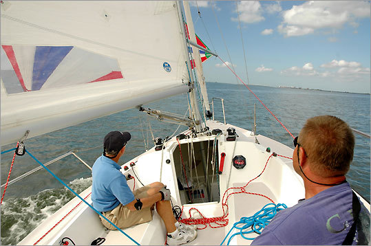 In the Gulf of Mexico, instructor Beite Cook (left) and student Charles Kiss have smooth sailing for their outing on San Carlos Bay off Fort Myers Beach.