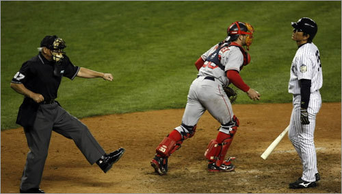 Boston Red Sox catcher Jason Varitek heads for the dugout, while Hideki Matsui reacts to being called out on strikes.