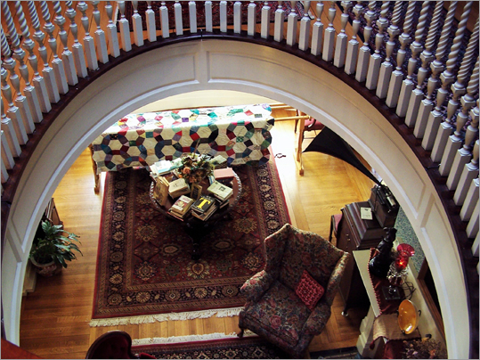 The view from the three-story atrium into the 'great hall' at Readmore Bed, Breakfast, & Books in Bellows Falls, Vt.