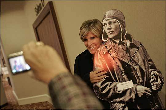 Personal finance author Suze Orman posed with a poster of Amelia Earhart before receiving the 24th Amelia Earhart Award from the Crittenton Women's Union. The Union is a nonprofit organization dedicated to helping low-income women attain economic independence. The charity event drew more than 1,000 people.