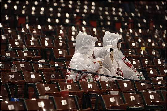 Hardy Red Sox fans were dressed for waiting out the rain delay in the eighth inning of last Saturday's game.