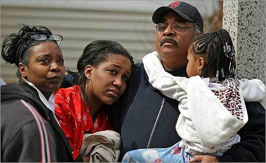 Shelby (left) and Paul Andrews comforted their daughter, Lucretia Godfrey, and her 5-year-old daughter, Breille, after they escaped from the third floor of their burning house. <br Boston firefighters battled the four-alarm fire at 51 Colonial Ave. in the Codman Square area, and no one was injured.