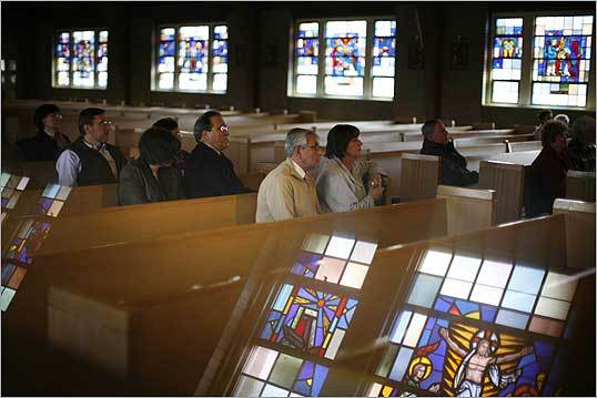 Several dozen people concerned about the closing of St. James the Great parish in Wellesley sat in pews during a press conference. The parishioners are in their fourth year of keeping a 24/7 vigil and called on the pope to stop the closings.