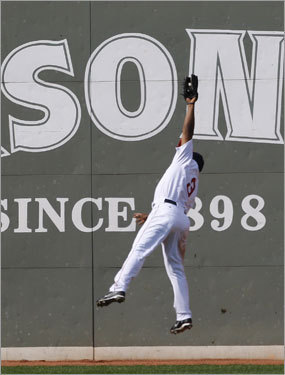 Red Sox left fielder Joe Thurston leaped high to rob Ian Kinsler of a hit in the eighth inning.