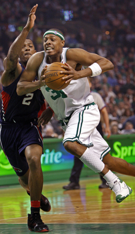 Paul Pierce drives against former teammate Joe Johnson and draws a foul in the first half.