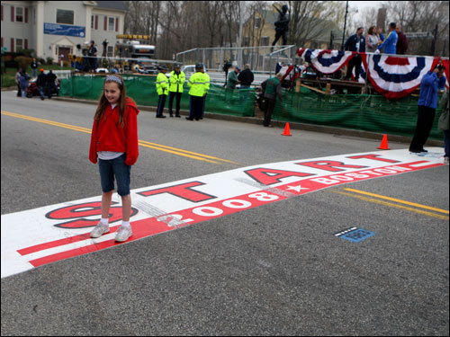 Emily Gildea stood at the starting line for a picture before the start of the 112th Boston Marathon.