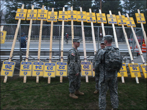 Army National Guard Captain Tim Van Deventer (left) stood near the starting line with the corrals.