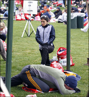 Veronique Bertrand of Montreal stretched in the Athlete's Village before the start of the 112th Boston Marathon.