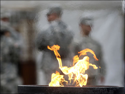 The Flame of the Marathon Run burned in the town common.
