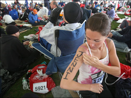 Jennifer Thompson of Sandy, UT cleaned up her name written on her arm after smudging it while applying suntan lotion at the Athletes Village.