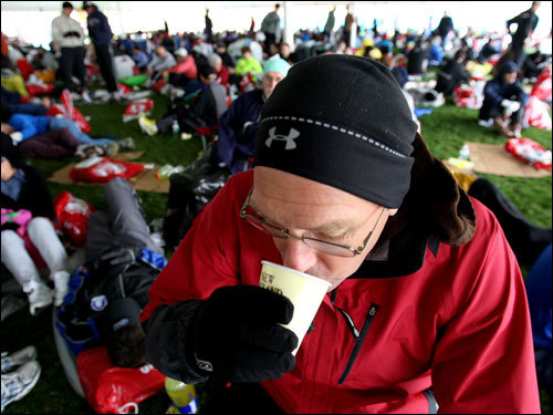 Michael McConnell of Aurora, Co., drank coffee at the Athletes Village.