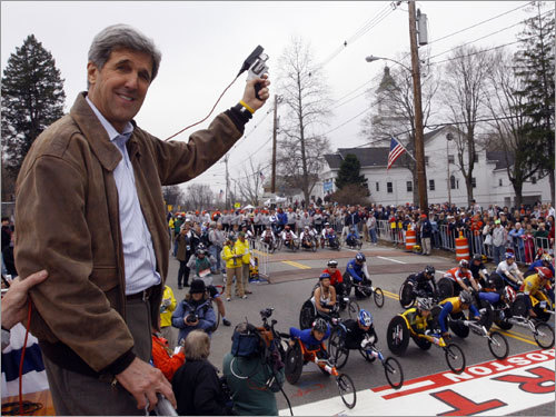 Senator John Kerry prepared to fire the start gun for the start of the wheelchair race, the first race to get underway Monday at the 112th Boston Marathon.