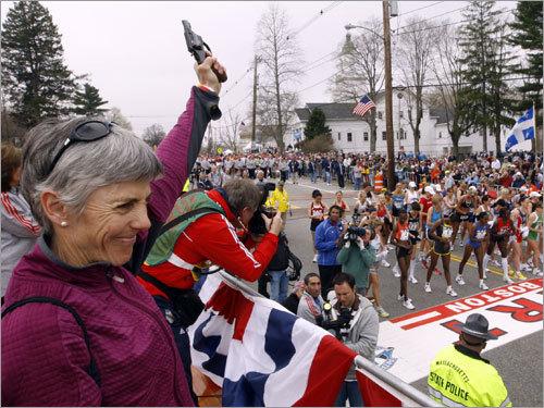 Joan Benoit Samuelson, two-time Boston Marathon winner and 1984 Olympic gold medalist, prepared to fire the start gun for the women's race.
