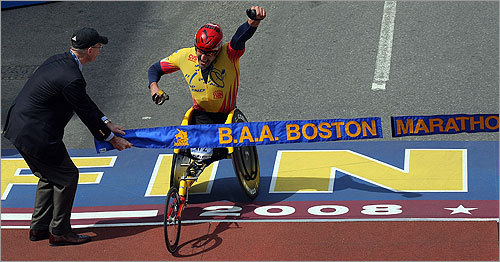 Wheelchair first-place winner Ernst Van Dyk of South Africa crossed the finish line at the 112th Boston Marathon. He held the lead from start to finish to win the race.
