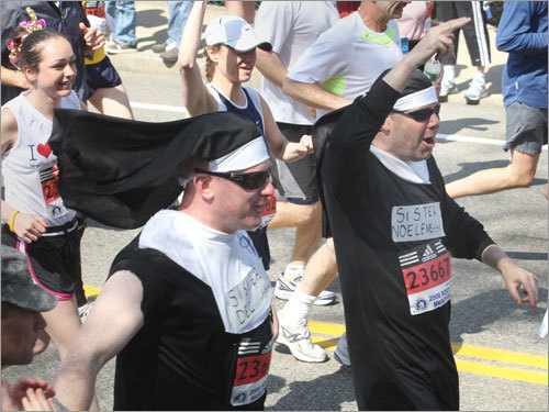 Runners dressed as nuns at the start of the Boston Marathon.