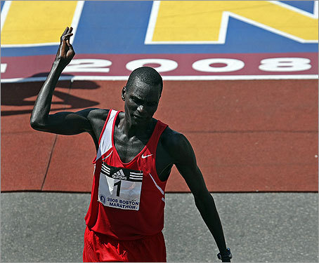 Cheruiyot held up four fingers to represent his four Boston Marathon wins.