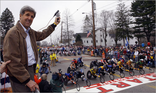 Senator John Kerry prepared to fire the start gun for the wheelchair race during the 112th Boston Marathon.