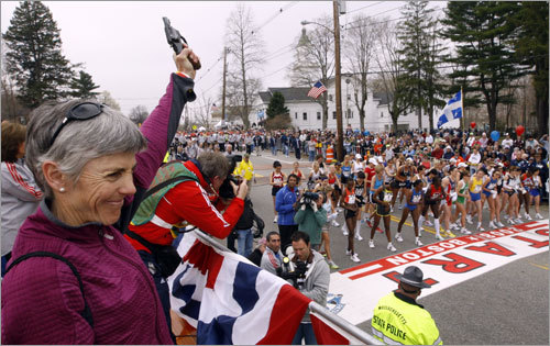 Joan Benoit Samuelson, two-time Boston Marathon winner and 1984 Olympic gold medalist, prepared to fire the start gun for the women's race.