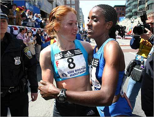 Alevtina Biktimirova (left, with Tune at the finish line) said she will return to Boston to try to win again, and is proud that she is continuing the tradition of other top Russian female runners.