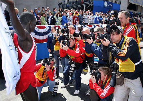 Immediately after his win, Cheruiyot was inundated by photographers at the finish line.